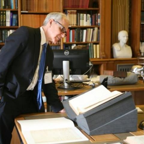 Art in a library, examining documents