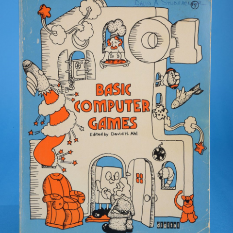 Cartoon designed cover of BASIC book on computer games