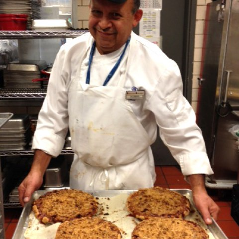 Chef holding a tray of apple pies