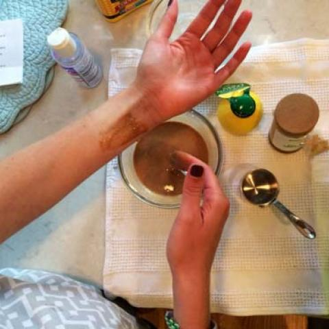 Trying deodorant on arm