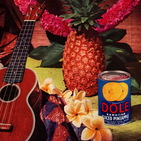 Dole pineapple ad in very saturated color with can, fruit, and ukulele