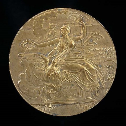 an Olympic gold medal. A woman in classical dress holding a laurel is etched on the front