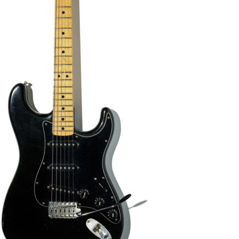 A white background with a black electric guitar.