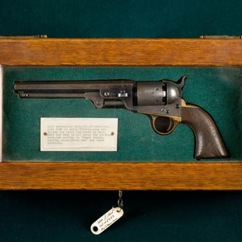 gun in wooden frame