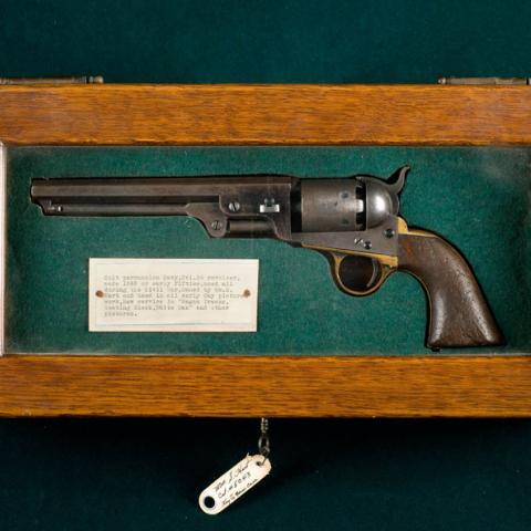 gun in wooden frame
