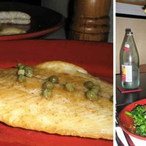 Sole meuniere, made with a recipe created by Julia Child, served at a table with flowers and salad