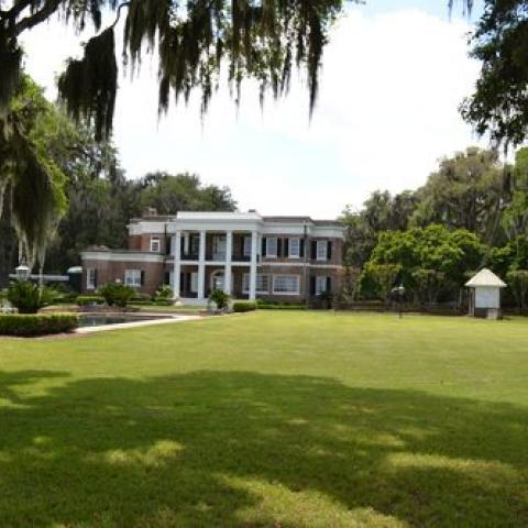 Ford's house with green lawn, columns