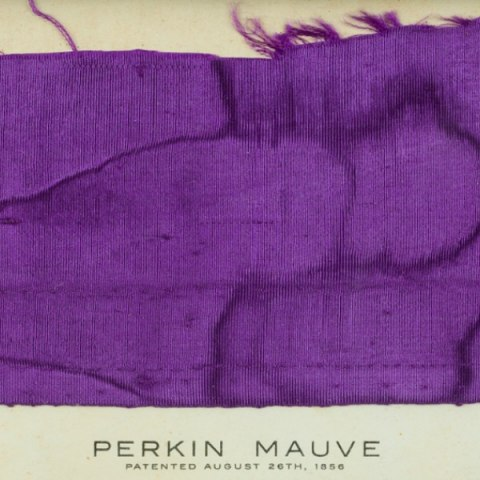 Vibrant purple fabric, with Perkin Mauve written below
