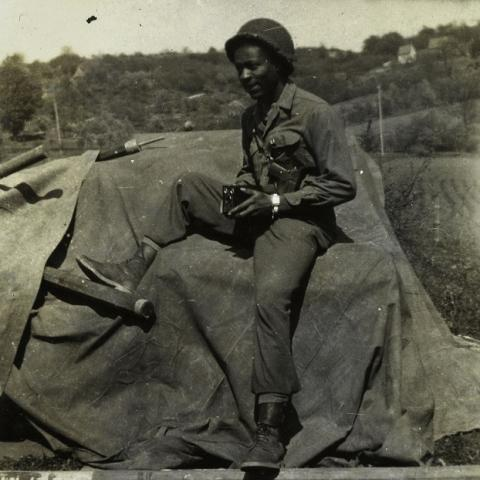 Man with camera in military uniform