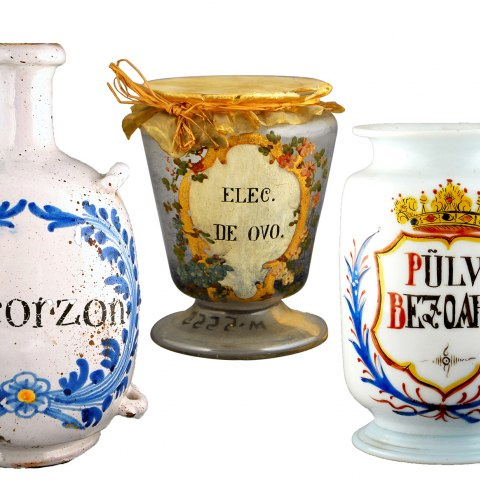 A long history of attempts at treating plague are represented in the museum's collections. Clockwise: a bottle to hold a preparation of scorzonera, or viper's grass; a container used to store a paste of eggs, honey, and other ingredients; a jar intended for pulverized bezoars; and a bezoar formed from ingested hair in the stomach of an ox.