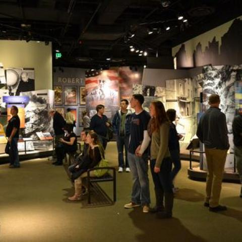Visitors in Price of Freedom exhibit