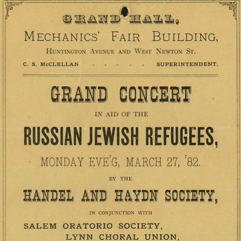 "A yellowed page with black text announcing the ""Grand Concert in aid of the Russian Jewish Refugees"""
