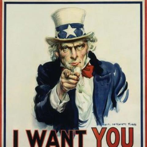 """Uncle Sam"" poster with pointing figure in a hat and beard"
