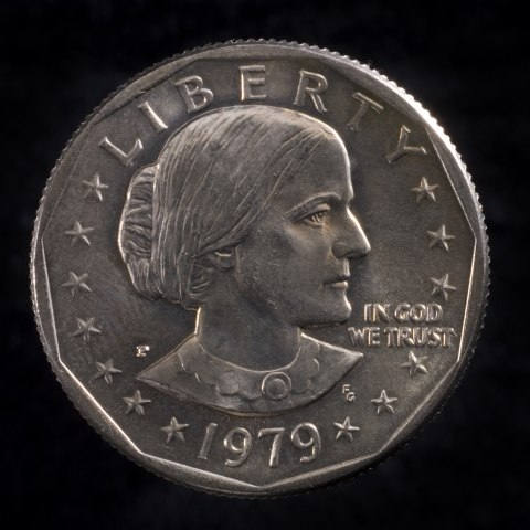 """A silver coin with a woman's likeness on the front. Reads """"Liberty"""" at the top and """"1979"""""""