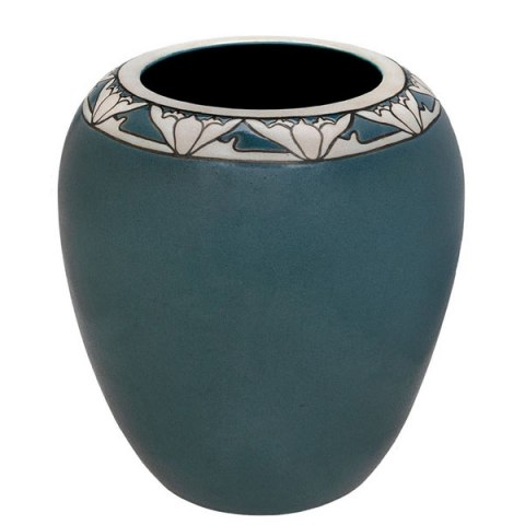 A blue vase with art nouveau style flowers around the lip.