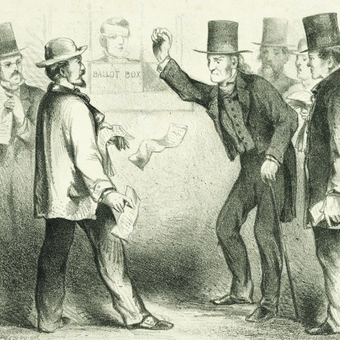 A print showing a group of men by the ballot box. One man is holding some papers in his hands while the man across from him had his arm raised, appearing to be on the verge of hitting something. The men wear top hats and there is text at the bottom that explains a conflict between voters about who they would want to vote for.
