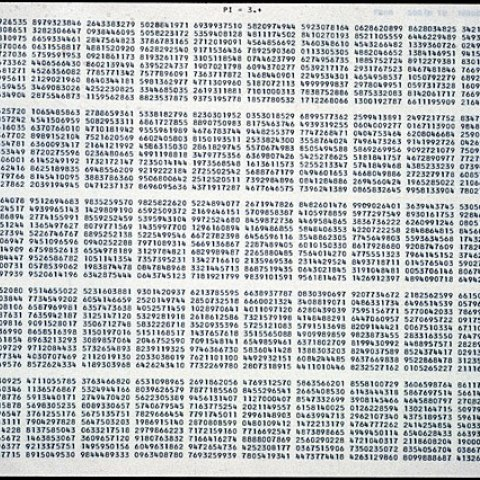 A piece of light colored paper. At the top reads PI = 3.* in typewriter typeface. Below are blocks of numbers sorted into rectangles in rows