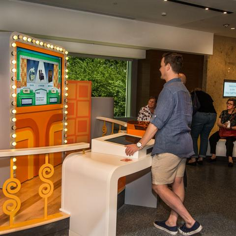 "Visitors playing ""The Price is Right"" at the museum"