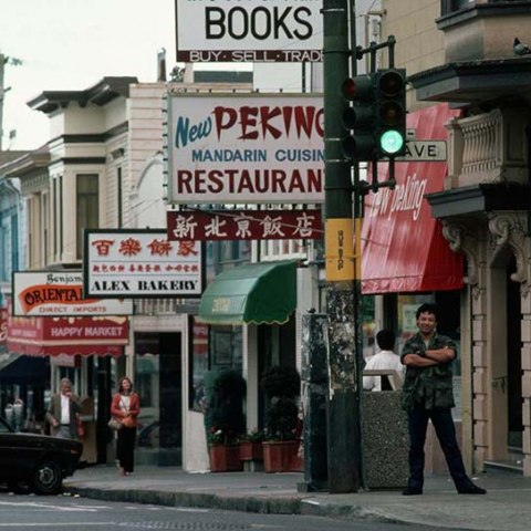 a street with chinese food signs in San Francisco