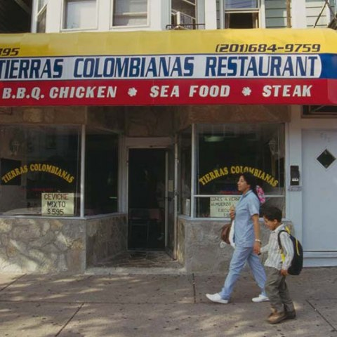 a columbian restaurant with a sign in red, blue, and yellow.
