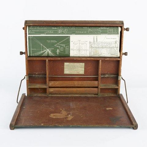 A wooden desk with compartments