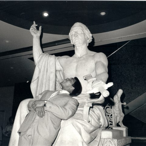 Boxing legend Muhammad Ali with Horace Greenough's 1840 statue of George Washington at the National Museum of American History in 1976.