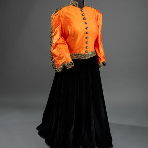 Shantung silk jacket (redesigned in 1993) and black velvet skirt worn by Marian Anderson.  (National Museum of African American History and Culture, Gift of Ginette DePriest in memory of James DePriest, Photograph by Hugh Talman, Smithsonian Institution)