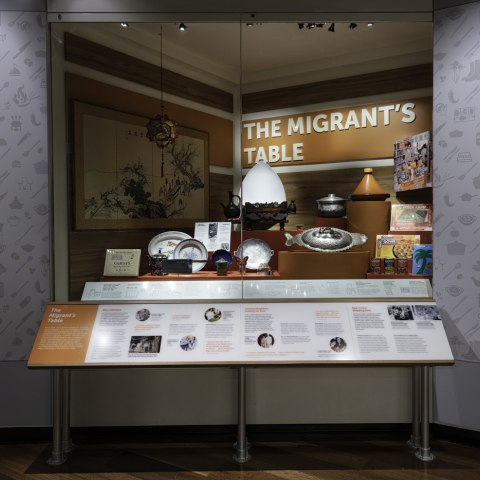 "A case with objects representing ""The Migrant's Table"""