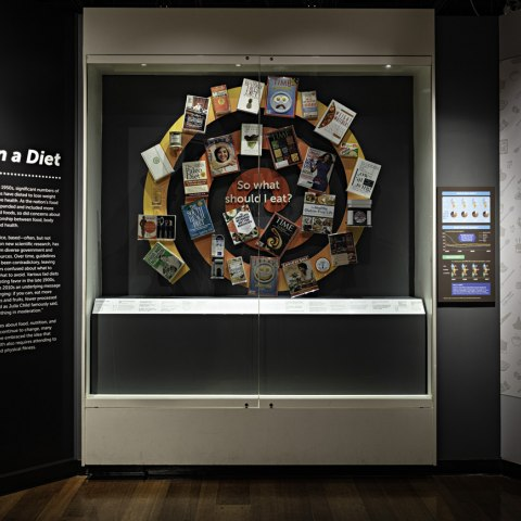 A spiral shape made of various diet books and articles from the 20th and 21st centuries