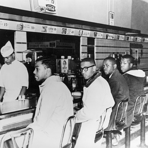 On the second day of the Greensboro sit-in, Joseph A. McNeil and Franklin E. McCain are joined by William Smith and Clarence Henderson at the Woolworth lunch counter in Greensboro, North Carolina. (Courtesy of Greensboro News and Record).