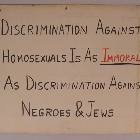 "Kameny protest sign: ""Discrimination Against Homosexuals is as Immoral as Discrimination Against Negroes and Jews"""