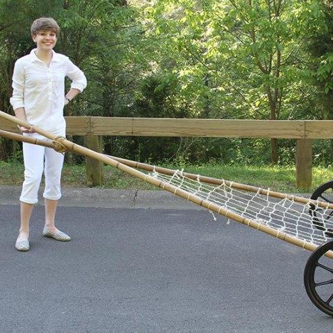 Woman displaying wheeled device