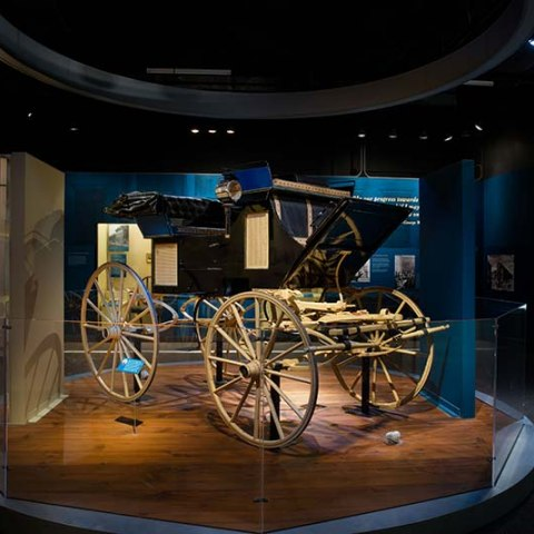 Photograph of exhibit entrance with wagon