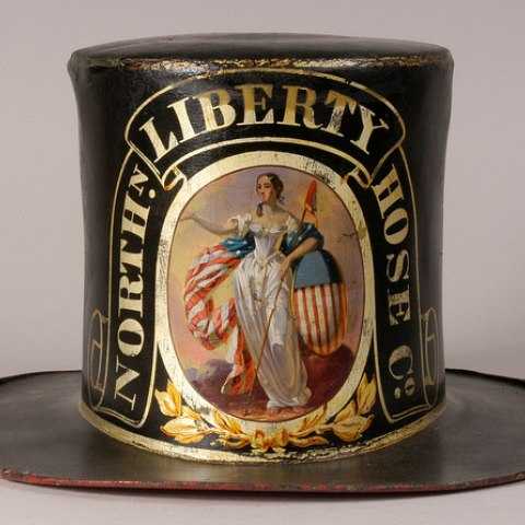 This fire hat includes the allegorical image of Columbia