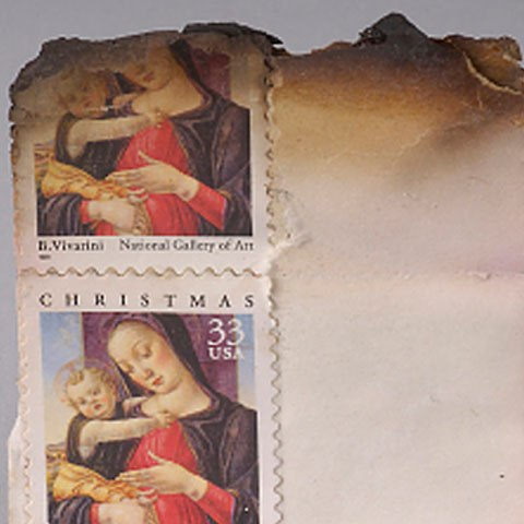Singed postage stamps recovered from the Pentagon
