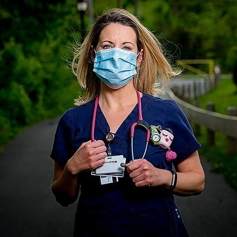 Woman in medical uniform, wearing mask