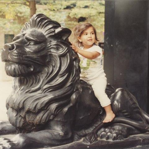 Child riding stone lion