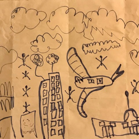 Child's drawing with black marker on tan paper of an airplane, people in the sky, tall buildings and clouds