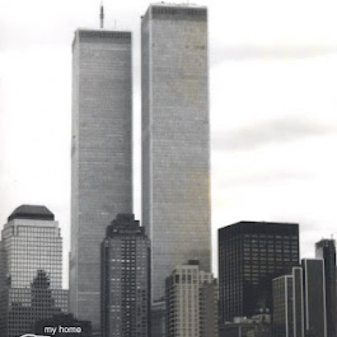 Black and white photograph of Twin Towers with graphic hand pointing and words my house