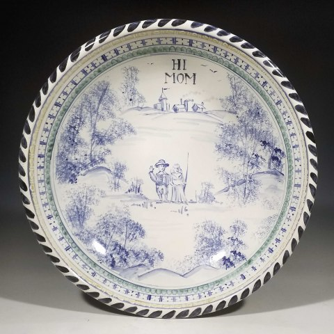 Blue and gray decorative platter with text Hi Mom at top center