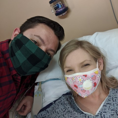 Masked man and woman in hospital room