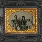 Family Portrait - An unidentified soldier in Union uniform poses with his wife and two daughters. (Library of Congress)