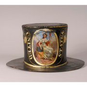"This fire hat was used by a member of the United States Hose Company of Philadelphia, Pennsylvania during the early 19th century. The hat is painted black overall with an image of Lady Liberty holding a liberty pole with Phrygian cap on top and her arm over a United States shield that reads ""Liberty."" The image is framed in an oval cartouche bordered in gold. There is a golden trimmed banner on either side of the central image that reads ""UNITED STATES"" in gold. The back of the hat has a golden image of a f"