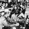 The 1963 photograph depicts students enduring taunts, mustard, and ketchup as they sat-in at a Woolworth's lunch counter in Jackson, Mississippi. Courtesy Wisconsin Historical Society.
