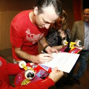 Tony Hawk signs deed of giftfor his skatedeck, photo by Lee Leal, Embassy Skateboards