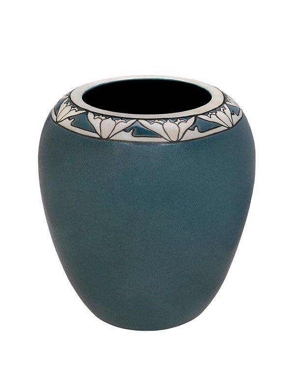 Tall vase with lotus flower design around the rim. The body of the vase is blue.